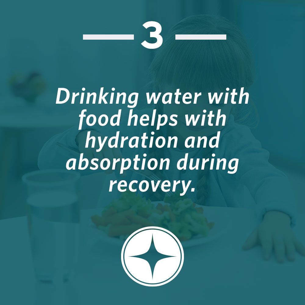Drinking water with food helps hydration and absorption during recovery.